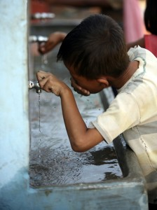 Boy drinking from tap